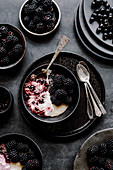 Breakfast pudding with blackberries, black currants, coconut cream and amaranth