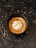 Vanilla ice cream with Dalgona coffee froth made from malt coffee