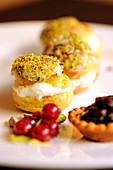 Cream puffs with gorgonzola cream and pistachios