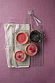 Raspberry tartlets on a cooling rack