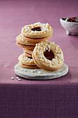 Linzer Plätzchen (nutty shortcrust jam sandwich biscuits with holes on top) with sugar nibs
