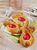 Yeast Easter bunnies with colorful Easter eggs