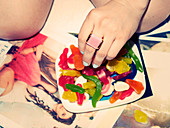A woman's hand with gummy sweets