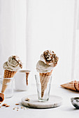 Ice cream in a cone with salted caramel and nuts