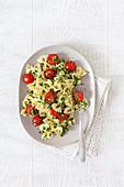 Pasta salad with cherry tomatoes and pesto