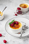 Cream brulee with raspberries and mint