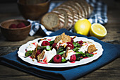 Raspberry and asparagus salad with ricotta and sourdough bread chips