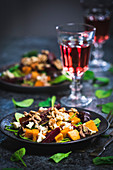 Sweet potato salad with spinach, honey, beetroot, goat cheese and walnuts
