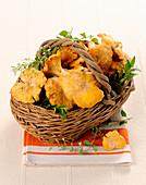 Fresh chanterelles in a basket