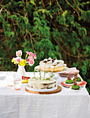 Cakes and pastries for Easter on a set table in a garden