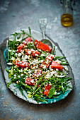 Rocket salad with watermelon and herbs