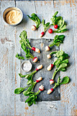 Radishes dipped in brown butter