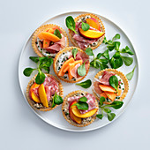 Small tartlets with fruit, ham and salami