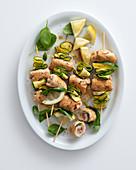 Chicken skewers with raw ham, ricotta and zucchini