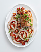 Turkey roll roast with tuna, peppers and capers