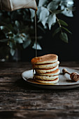 Mini American pancakes with maple syrup
