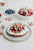 Cream tart with strawberries currants and blueberries