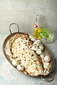 Gebackener Kokoslachs mit Reisbällchen
