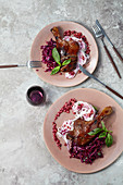 Roasted duck leg with rice noodles and pomegranate relish