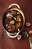 Stew pot with lamb, beef brisket and fresh figs