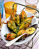 Zucchini flowers with fish filling
