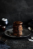 Chocolate pancakes topped with melted dark chocolate
