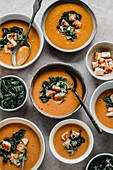 Pumpkin cream soup with kale and halloumi cheese