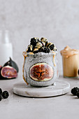 Chia pudding with fresh figs, peanut butter and blackberries