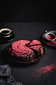 Chocolate cake sprinkled with raspberry powder