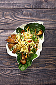 Kohlrabi and spaghetti salad with oyster mushrooms and chili peppers