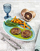 Portobello mushroom steaks on a green herb sauce