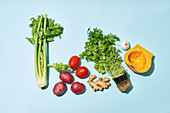 Vegetables, herbs, spices on a blue background