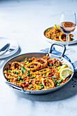 Calamari jambalaya with pea and corn rice