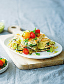 Cheesy caramelised leek and chicken quesadillas with avocado dip