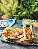 Salmon tacos with radish and mangetout