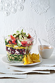 Colorful 'Flower Power' layered salad with wheat and turkey
