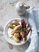 Large walnut gnocchi with chorizo filling
