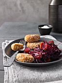 Chickpea dumplings wrapped in sesame seeds with braised red cabbage