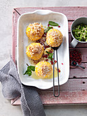 Polenta and coconut dumplings with kiwi and honey salsa