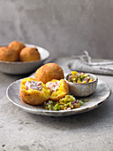 Fried Sicilian rice dumplings with a ricotta and ham filling