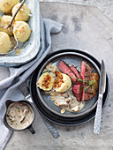 Steaks with almond potato dumplings and creamy mushroom sauce