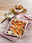 Grilled salmon skewers with zucchini vegetables