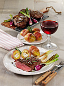 Grilled rump steaks with stuffed potatoes