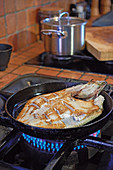 Turbot being fried