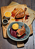 Duck leg with plum sauce and potato soufflé