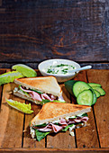 Sandwiches made with cos lettuce, ham, cucumber and remoulade