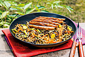 Fried noodles with Chinese morel mushrooms and duck breast