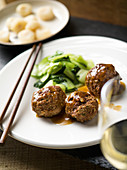 Chinese meatballs with bok choy and water chestnuts