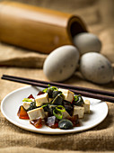 Pidan (thousand year-old eggs) with tofu, China