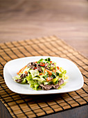 Chinese beef salad with iceberg lettuce, vinegar and chilli